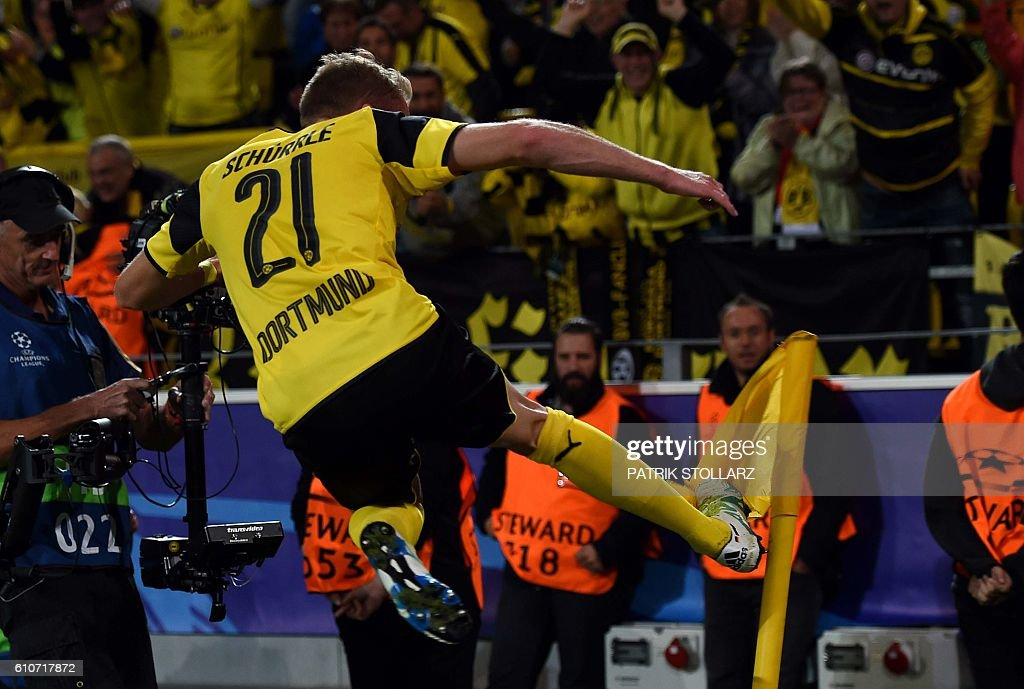 Dortmund's midfielder André Schuerrle celebrates after scoring during the UEFA Champions League first leg football match between Borussia Dortmund and Real Madrid at BVB stadium in Dortmund, on September 27, 2016. / AFP / PATRIK