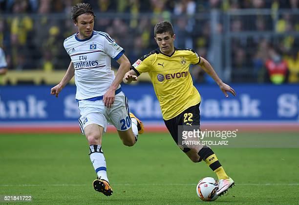 Dortmund's midfielder Christian Pulisic and Hamburg's Swedish midfielder Albin Eckdal vie for the ball during the German Bundesliga first division...