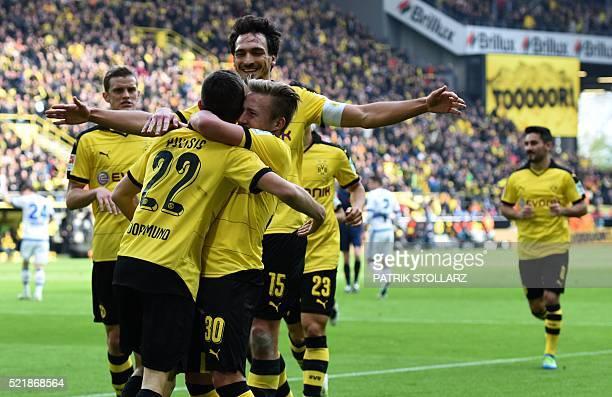Dortmund's midfielder Christian Pulisic and his teammates celebrate during the German Bundesliga first division football match BVB Borussia Dortmund...