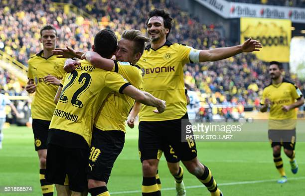 Dortmund's midfielder Christian Pulisic and his teammates celebrate during the German Bundesliga first division football match BVB Borussia Dortmund...