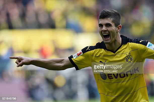 Dortmund's midfielder Christian Pulisic celebrates scoring the 10 goal during the German Bundesliga first division football match BVB Borussia...