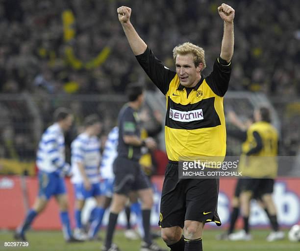 Dortmund's midfielder Florian Kringe celebrates his team's third goal during the German Cup semifinal football match Borussia Dortmund vs FC Carl...