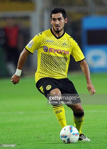 Dortmund's midfielder Ilkay Guendogan plays the ball during the German first division Bundesliga football match Borussia Dortmund vs Hamburger SV in...