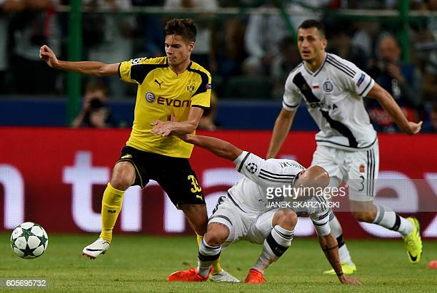 Dortmund's midfielder Julian Weigl and Legia Warsaw's defender Jakub Czerwinski vie for the ball during the UEFA Champions League group F football...