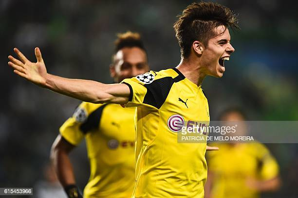 TOPSHOT Dortmund's midfielder Julian Weigl celebrates after scoring during the UEFA Champions League football match Sporting CP vs BVB Borussia...