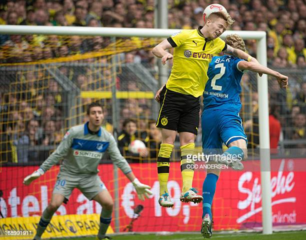 Dortmund's midfielder Marco Reus and Hoffenheim's Andreas Beck vie for the ball during the German first division Bundesliga football match between...