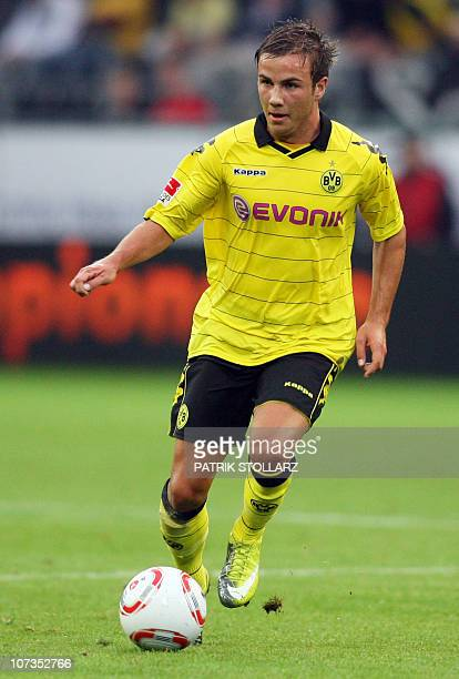 Dortmund's midfielder Mario Goetze runs with the ball during the pre-season test football match Borussia Dortmund vs Manchester City at the Signal...