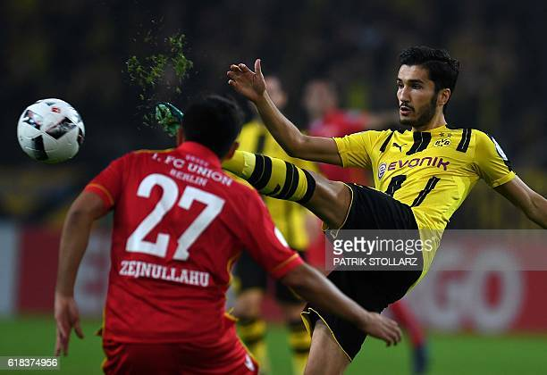 Dortmund's midfielder Nuri Sahin and Berlin´s Eroll Zejnullahu vie for the ball during the German Cup DFB Pokal second round football match BVB...