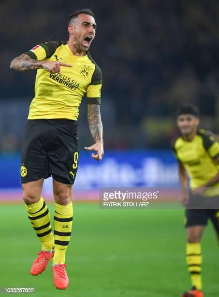 Dortmund's midfielder Paco Alacer celebrates after scoring during the German first division Bundesliga football match Borussia Dortmund v Eintracht...