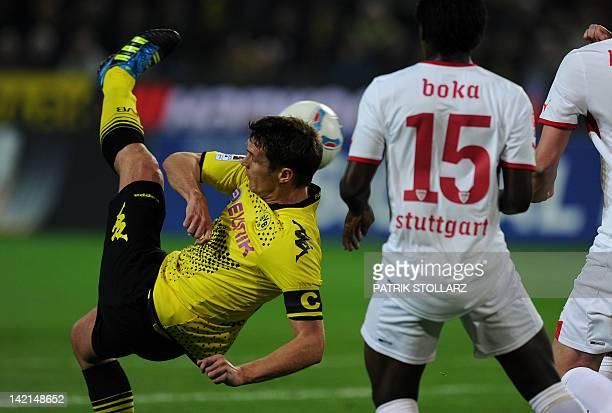 Dortmund's midfielder Sebastian Kehl dribbles by Stuttgart's Ivorian defender Arthur Boka during the German first division Bundesliga football match...