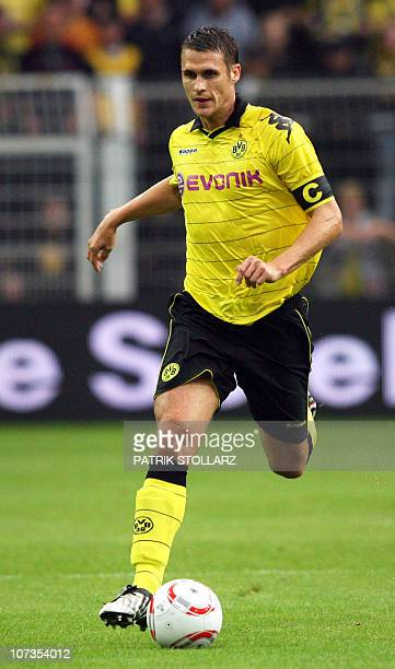 Dortmund's midfielder Sebastian Kehl runs with the ball during the preseason football test match Borussia Dortmund vs Manchester City at the Signal...