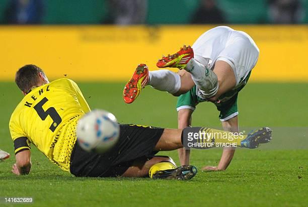 Dortmund's midfielder Sebastian Kehl stops Fuerth's midfielder Felix Klaus during the German Football League DFB Cup semi-final match between SpVgg...