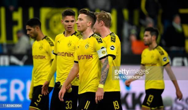 Dortmund's Moroccan defender Achraf Hakimi Dortmund's German midfielder Julian Weigl Dortmund's German midfielder Marco Reus Dortmund's German...