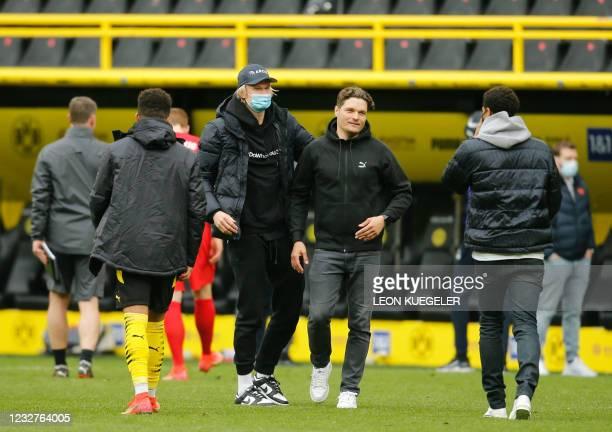 Dortmund's Norwegian forward Erling Braut Haaland and Dortmund's coach Edin Terzic walk over the pitch after the German first division Bundesliga...