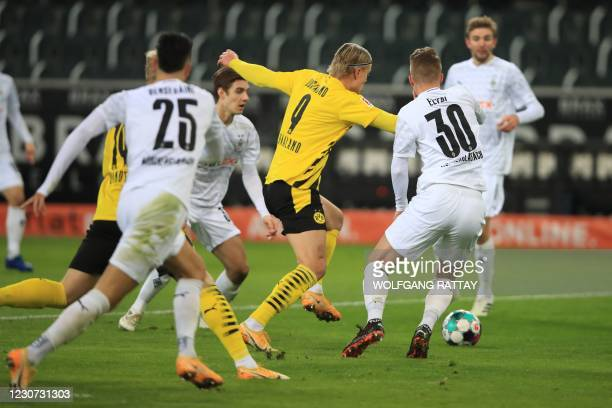 Dortmund's Norwegian forward Erling Braut Haaland and Moenchengladbach's Swiss defender Nico Elvedi vie for the ball during the German first division...