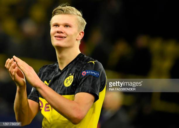 TOPSHOT Dortmund's Norwegian forward Erling Braut Haaland applauds as he leaves the pitch after the UEFA Champions League Last 16 firstleg football...