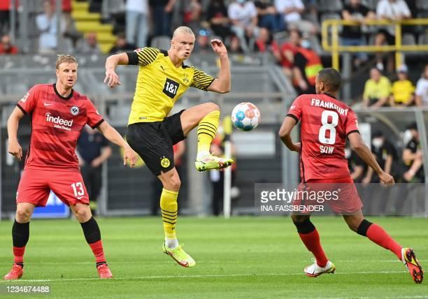 Dortmund's Norwegian forward Erling Braut Haaland (C0 and Frankfurt's Swiss midfielder Djibril Sow vie for the ball during the German first division...