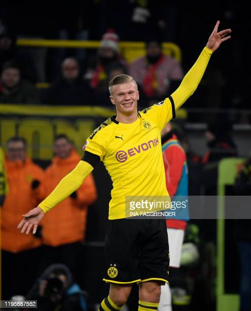 Dortmund's Norwegian forward Erling Braut Haaland celebrate scoring the 41 goal during the German first division Bundesliga football match Borussia...
