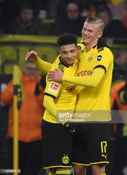 Dortmund's Norwegian forward Erling Braut Haaland celebrate scoring the 41 goal with his teammate Dortmund's English midfielder Jadon Sancho during...
