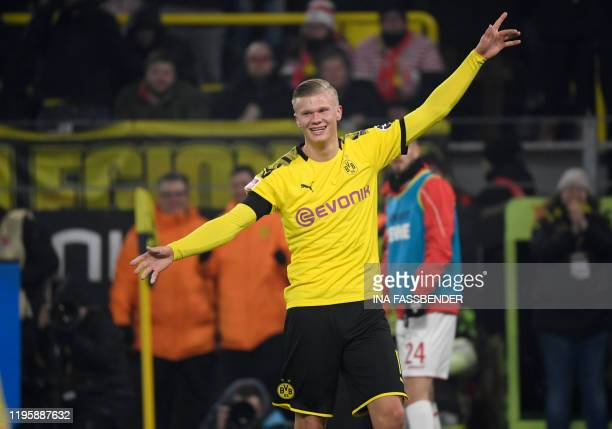 Dortmund's Norwegian forward Erling Braut Haaland celebrate scoring the 4-1 goal during the German first division Bundesliga football match Borussia...