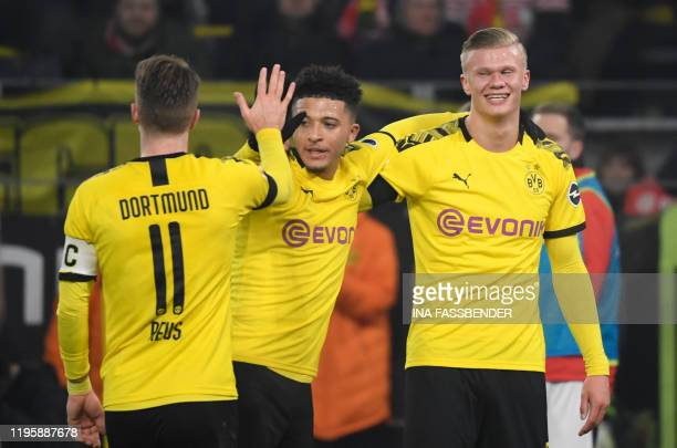 Dortmund's Norwegian forward Erling Braut Haaland celebrate scoring the 41 goal with his teammates Dortmund's German forward Marco Reus and...