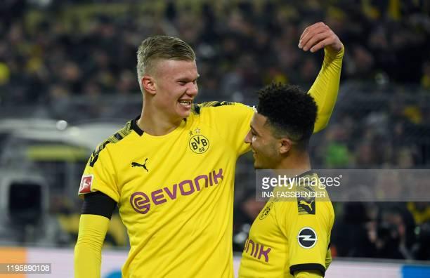 Dortmund's Norwegian forward Erling Braut Haaland celebrate scoring the 41 goal with Dortmund's English midfielder Jadon Sancho during the German...