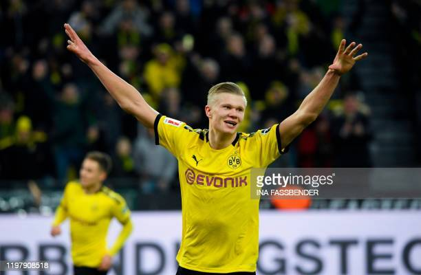 Dortmund's Norwegian forward Erling Braut Haaland celebrates after scoring during the German first division Bundesliga football match Borussia...