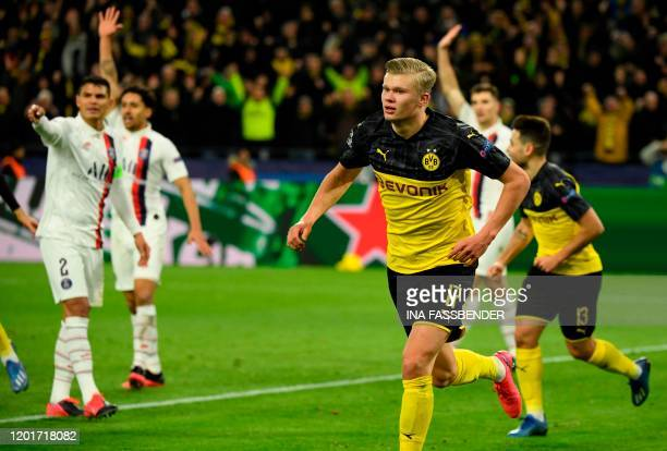 Dortmund's Norwegian forward Erling Braut Haaland celebrates after scoring the 10 during the UEFA Champions League Last 16 firstleg football match...