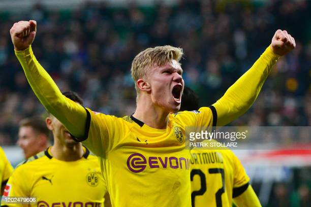 Dortmund's Norwegian forward Erling Braut Haaland celebrates after scoring during the German first division Bundesliga football match Werder Bremen...