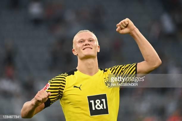 Dortmund's Norwegian forward Erling Braut Haaland celebrates at the end of the German first division Bundesliga football match between Borussia...