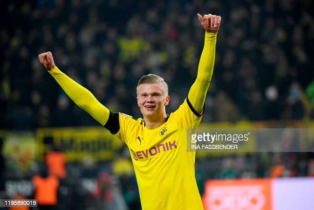 Dortmund's Norwegian forward Erling Braut Haaland celebrates scoring during the German first division Bundesliga football match Borussia Dortmund v...