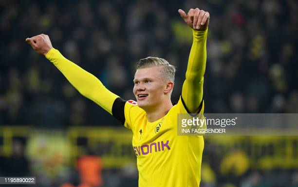 Dortmund's Norwegian forward Erling Braut Haaland celebrates scoring during the German first division Bundesliga football match Borussia Dortmund v...