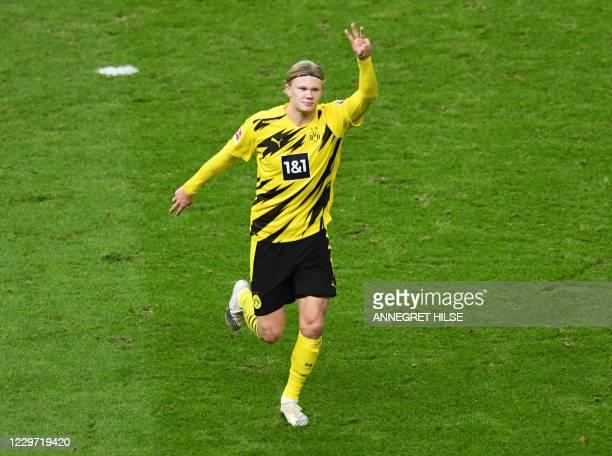 Dortmund's Norwegian forward Erling Braut Haaland celebrates scoring their third goal and his hattrick during the German first division Bundesliga...