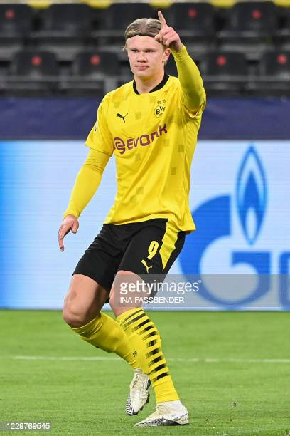 Dortmund's Norwegian forward Erling Braut Haaland celebrates scoring the opening goal during the UEFA Champions League group F football match BVB...