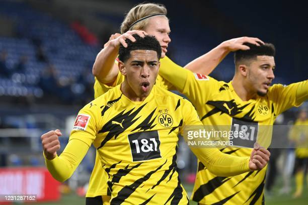 Dortmund's Norwegian forward Erling Braut Haaland celebrates scoring the 4-0 goal with Dortmund's English midfielder Jude Bellingham and Dortmund's...