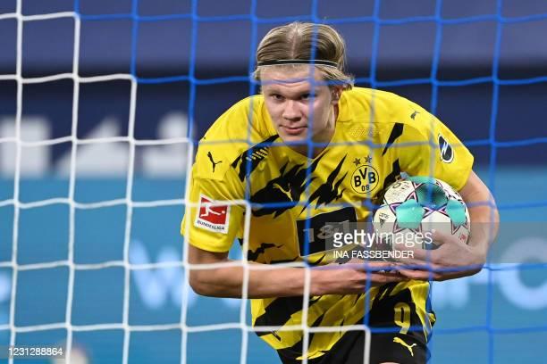 Dortmund's Norwegian forward Erling Braut Haaland celebrates scoring the 4-0 goal during the German first division Bundesliga football match FC...