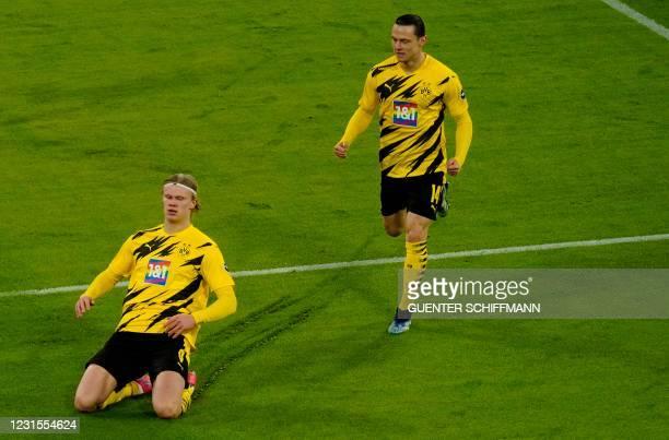 Dortmund's Norwegian forward Erling Braut Haaland celebrates scoring the 0-1 during the German first division Bundesliga football match between FC...