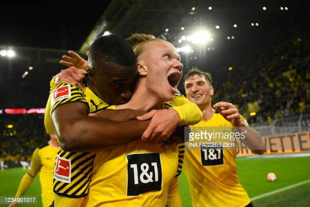 Dortmund's Norwegian forward Erling Braut Haaland celebrates scoring the 3-2 goal with team mates Dortmund's German forward Youssoufa Moukoko and...