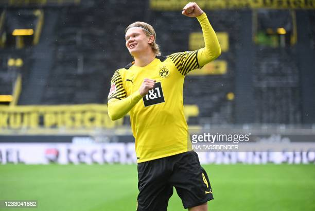 Dortmund's Norwegian forward Erling Braut Haaland celebrates the 1-0 during the German first division Bundesliga football match Borussia Dortmund vs...