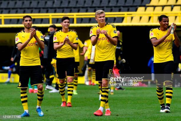 Dortmund's Norwegian forward Erling Braut Haaland celebrates with his teammates their victory 40 after the German first division Bundesliga football...