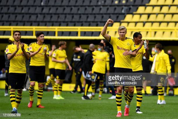 Dortmund's Norwegian forward Erling Braut Haaland celebrates with his teammates their victory 4:0 after the German first division Bundesliga football...
