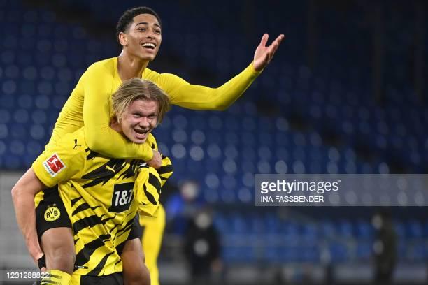 Dortmund's Norwegian forward Erling Braut Haaland celebrates with Dortmund's English midfielder Jude Bellingham after the German first division...