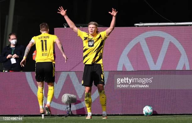 Dortmund's Norwegian forward Erling Braut Haaland celebrates with Dortmund's German forward Marco Reus after scoring his team's second goal during...
