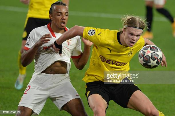 Dortmund's Norwegian forward Erling Braut Haaland challenges Sevilla's French defender Jules Kounde during the UEFA Champions League round of 16...
