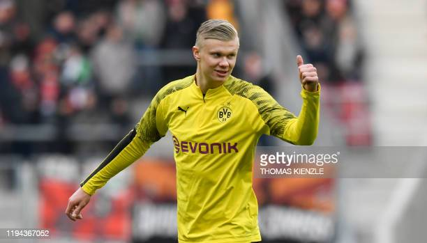 Dortmund's Norwegian forward Erling Braut Haaland gives a thumb during the warm up session before the German first division Bundesliga football match...