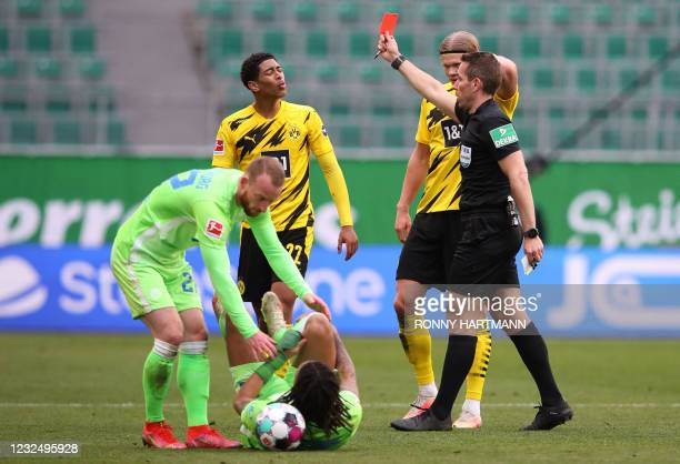 Dortmund's Norwegian forward Erling Braut Haaland looks on as referee Tobias Stieler shows the red card to Dortmund's English midfielder Jude...