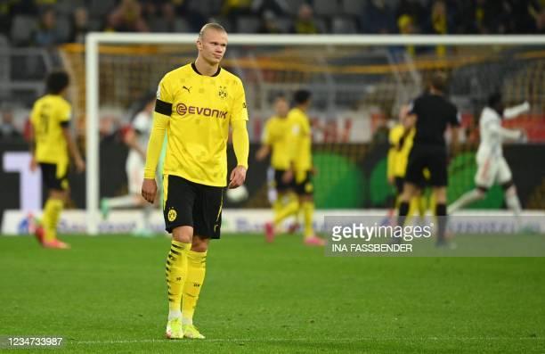 Dortmund's Norwegian forward Erling Braut Haaland reacts after the 0-2 during the German Supercup football match BVB Borussia Dortmund vs FC Bayern...