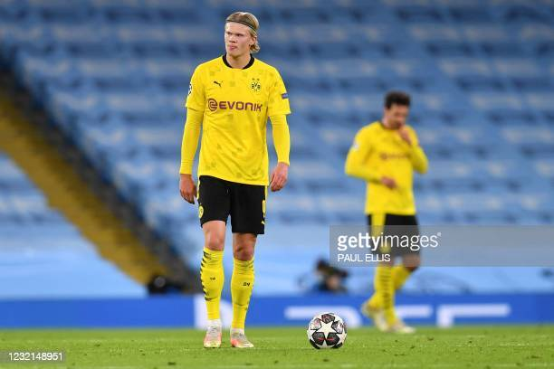 Dortmund's Norwegian forward Erling Braut Haaland reacts after the team conceded the opening goal during the UEFA Champions League first leg...