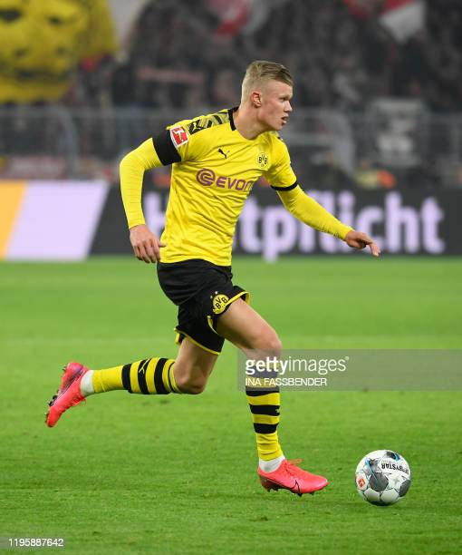 Dortmund's Norwegian forward Erling Braut Haaland runs with the ball during the German first division Bundesliga football match Borussia Dortmund v...