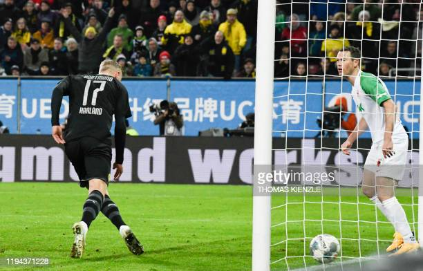 Dortmund's Norwegian forward Erling Braut Haaland scores his 2nd goal during the German first division Bundesliga football match Augsburg v Borussia...